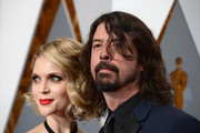 Jordyn Blum (L) and musician Dave Grohl attend the 88th Annual Academy Awards at Hollywood & Highland Center on February 28, 2016 in Hollywood, California.