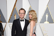 Filmmaker Tom McCarthy (L) and Wendy Merry McCarthy attend the 88th Annual Academy Awards at Hollywood & Highland Center on February 28, 2016 in Hollywood, California.