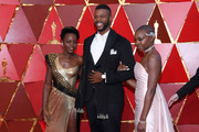 (L-R) Lupita Nyong'o, Winston Duke, and Danai Gurira attends the 90th Annual Academy Awards at Hollywood & Highland Center on March 4, 2018 in Hollywood, California.