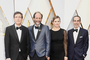 (L-R) Peter Spears, Luca Guadagnino, Emilie Georges, and Marco Morabito attend the 90th Annual Academy Awards at Hollywood & Highland Center on March 4, 2018 in Hollywood, California.