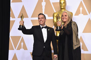 Director Lee Unkrich (L) and producer Darla K. Anderson, winners of the Animated Feature award for ?'Coco?,' pose in the press room during the 90th Annual Academy Awards at Hollywood & Highland Center on March 4, 2018 in Hollywood, California.