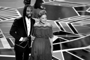 Image has been converted to black and white.) Singers Miguel (L) and Natalia Lafourcade perform onstage during the 90th Annual Academy Awards at the Dolby Theatre at Hollywood & Highland Center on March 4, 2018 in Hollywood, California.