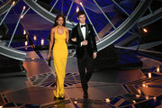 Presenters Eiza Gonzalez (L) and Ansel Elgort onstage during the 90th Annual Academy Awards at the Dolby Theatre at Hollywood & Highland Center on March 4, 2018 in Hollywood, California.