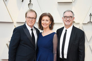 (L-R) Brad Bird, Nicole Paradis Grindle and John Walker attend the 91st Annual Academy Awards at Hollywood and Highland on February 24, 2019 in Hollywood, California.