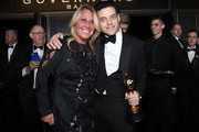 Rami Malek (R), winner of the Actor in a Leading Role award for 'Bohemian Rhapsody,' and a guest attend the 91st Annual Academy Awards Governors Ball at Hollywood and Highland on February 24, 2019 in Hollywood, California.