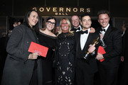 Rami Malek (2nd R), winner of the Actor in a Leading Role award for 'Bohemian Rhapsody,' and guests attend the 91st Annual Academy Awards Governors Ball at Hollywood and Highland on February 24, 2019 in Hollywood, California.