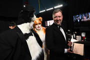 In this handout photo provided by A.M.P.A.S. James Corden, Rebel Wilson, and Visual Effects award winner Greg Butler walk backstage during the 92nd Annual Academy Awards at the Dolby Theatre on February 09, 2020 in Hollywood, California.