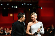 In this handout photo provided by A.M.P.A.S. Rami Malek and Best Actress award winner Renée Zellweger walk backstage during the 92nd Annual Academy Awards at the Dolby Theatre on February 09, 2020 in Hollywood, California.