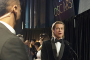 In this handout photo provided by A.M.P.A.S. Best Actor in a Supporting Role winner Brad Pitt speaks backstage during the 92nd Annual Academy Awards at the Dolby Theatre on February 09, 2020 in Hollywood, California.