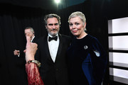 In this handout photo provided by A.M.P.A.S. Best Actor award winner Joaquin Phoenix and Olivia Colman stand backstage during the 92nd Annual Academy Awards at the Dolby Theatre on February 09, 2020 in Hollywood, California.