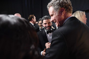 In this handout photo provided by A.M.P.A.S. Oscar Isaac and Will Ferrell speak backstage during the 92nd Annual Academy Awards at the Dolby Theatre on February 09, 2020 in Hollywood, California.
