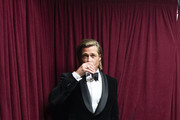 In this handout photo provided by A.M.P.A.S. Best Actor in a Supporting Role winner Brad Pitt stands backstage during the 92nd Annual Academy Awards at the Dolby Theatre on February 09, 2020 in Hollywood, California.