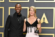"""Mahershala Ali (L) with Laura Dern, winner of the Actress in a Supporting Role award for """"Marriage Story,"""" poses in the press room during the 92nd Annual Academy Awards at Hollywood and Highland on February 09, 2020 in Hollywood, California."""