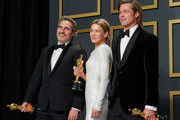 """L-R) Joaquin Phoenix, winner of the Actor in a Leading Role award for """"Joker,"""" Renée Zellweger, winner of the Actress in a Leading Role award for """"Judy,"""" and Brad Pitt, winner of the Actor in a Supporting Role award for """"Once Upon a Time in Hollywood,"""" pose in the press room during the 92nd Annual Academy Awards at Hollywood and Highland on February 09, 2020 in Hollywood, California."""