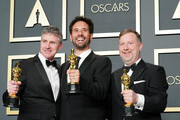 """L-R) Dominic Tuohy, Guillaume Rocheron and Greg Butler, winners of the Visual Effects award for """"1917,"""" pose in the press room during the 92nd Annual Academy Awards at Hollywood and Highland on February 09, 2020 in Hollywood, California."""