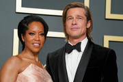 """(L-R) Regina King and Brad Pitt, winner of the Actor in a Supporting Role award for """"Once Upon a Time...in Hollywood"""" pose in the press room during the 92nd Annual Academy Awards at Hollywood and Highland on February 09, 2020 in Hollywood, California."""