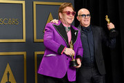 """Musician Elton John and lyricist Bernie Taupin, winners of the Original Song award for """"'(I'm Gonna) Love Me Again,' Rocketman,"""" pose in the press room during the 92nd Annual Academy Awards at Hollywood and Highland on February 09, 2020 in Hollywood, California."""