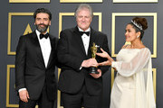 """Sound engineer Donald Sylvester, winner of the Sound Editing award for """"Ford v Ferrar,"""" poses with Oscar Isaac (L) and Salma Hayek (R) in the press room during the 92nd Annual Academy Awards at Hollywood and Highland on February 09, 2020 in Hollywood, California."""