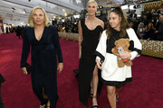 Gerda Jacoba Aletta Maritz (L) and Charlize Theron (C) attend the 92nd Annual Academy Awards at Hollywood and Highland on February 09, 2020 in Hollywood, California.