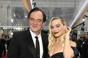 Quentin Tarantino and Margot Robbie Photos Photo