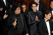 (L-R) Bong Joon-ho and Yang Jin-mo accept the Best Picture award for 'Parasite' onstage during the 92nd Annual Academy Awards at Dolby Theatre on February 09, 2020 in Hollywood, California.