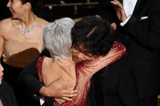 Jane Fonda (C) presents the Best Picture award for 'Parasite' to Bong Joon-ho onstage during the 92nd Annual Academy Awards at Dolby Theatre on February 09, 2020 in Hollywood, California.