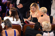 (L-R) Margot Robbie and Charlize Theron attend the 92nd Annual Academy Awards at Dolby Theatre on February 09, 2020 in Hollywood, California.