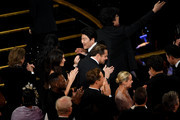 (L-R) Kang-ho Song, Leonardo DiCaprio, and Bong Joon-ho attend the 92nd Annual Academy Awards at Dolby Theatre on February 09, 2020 in Hollywood, California.
