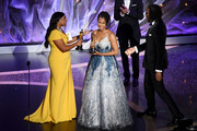 (L-R) Mindy Kaling presents the Animated Short Film award for 'Hair Love' to Karen Rupert Toliver and Matthew A. Cherry onstage during the 92nd Annual Academy Awards at Dolby Theatre on February 09, 2020 in Hollywood, California.