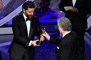 (L-R) Oscar Isaac presents the Sound Editing award for 'Ford v Ferrari' to Donald Sylvester onstage during the 92nd Annual Academy Awards at Dolby Theatre on February 09, 2020 in Hollywood, California.