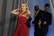 Reese Witherspoon enters the press room at the Oscars on Sunday, April 25, 2021, at Union Station in Los Angeles.