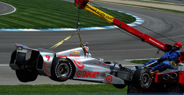 The #9 Target Chip Ganassi Racing Dallara Chevrolet  of Scott Dixon of New Zealand gets towed after crashing during the 98th running of the Indianapolis 500 mile race at the Indianapolis Motor Speedway on May 25, 2014 in Indianapolis, Indiana.