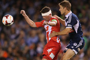 Harry Kewell of the Heart and Adrian Leijer (R) of the Victory contest for the ball during the round one A-League match between the Melbourne Victory and the Melbourne Heart at Etihad Stadium on October 12, 2013 in Melbourne, Australia.