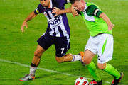 Ufuk Talay of the Fury contests the ball with Jacob Burns of the Glory during the round ten A-League match between the North Queensland Fury and the Perth Glory at Dairy Farmers Stadium on October 15, 2010 in Townsville, Australia.