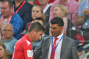 Heart Head Coach John Aloisi shakes the hand of Harry Kewell of the Heart as he is substituted off during the round 11 A-League match between Melbourne Heart and Melbourne Victory at AAMI Park on December 21, 2013 in Melbourne, Australia.