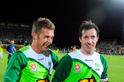 (L-R) Ufuk Talay of the Fury celebrates with Robbie Fowler after the round 12 A-League match between the North Queensland Fury and the Perth Glory at Dairy Farmers Stadium on October 24, 2009 in Townsville, Australia.