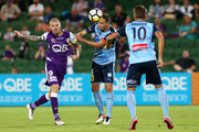 Alex Wilkinson of Sydney heads the ball against Andy Keogh of the Glory during the round 25 A-League match between the Perth Glory and Sydney FC at nib Stadium on March 29, 2018 in Perth, Australia.
