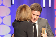 Writer Nancy Meyers (L) accepts the Best Comedy award for 'The Intern' from actor Adam Devine onstage at the AARP's 15th Annual Movies For Grownups Awards at the Beverly Wilshire Four Seasons Hotel on February 8, 2016 in Beverly Hills, California.