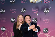 Camryn Manheim and Adrian Martinez attend ABC's TCA Summer Press Tour Carpet Event on August 05, 2019 in West Hollywood, California.