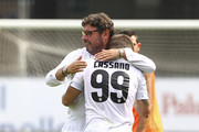 Antonio Cassano #99 of Parma FC embraces General Manager of Parma FC Pietro Leonardi at the end of the Serie A match between AC Chievo Verona and Parma FC  at Stadio Marc'Antonio Bentegodi on September 21, 2014 in Verona, Italy.