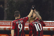 Jeremy Menez (R) of AC Milan celebrates with his team mates Keisuke Honda (C) and Mattia Destro (L) after scoring the opening goal during the Serie A match between AC Milan and Cagliari Calcio at Stadio Giuseppe Meazza on March 21, 2015 in Milan, Italy.