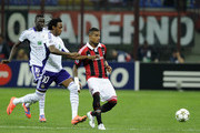 Kevin Prince Boateng of AC Milan and Kanu (L) of RSC Anderlecht compete for the ball during the UEFA Champions League group C match between AC Milan and RSC Anderlecht at Stadio Giuseppe Meazza on September 18, 2012 in Milan, Italy.