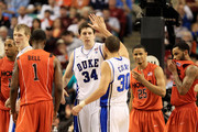 Ryan Kelly #34 and Seth Curry #30 of the Duke Blue Devils show camaraderie against the Virginia Tech Hokies during the second half in the semifinals of the 2011 ACC men's basketball tournament at the Greensboro Coliseum on March 12, 2011 in Greensboro, North Carolina.