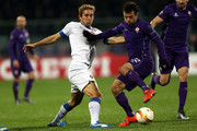 Giuseppe Rossi of ACF Fiorentina battles for the ball with Goncalo Silva of OS Belenenses during the UEFA Europa League match between ACF Fiorentina and Os Belenenses on December 10, 2015 in Florence, Italy.