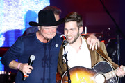 (L-R) Tracy Lawrence and Carlton Anderson perform onstage at ACM Lifting Lives®: Decades on April 06, 2019 in Las Vegas, Nevada.