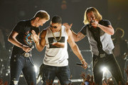 Musicians Brian Kelley (L) and Tyler Hubbard (R) of Florida Georgia Line perform with rapper Nelly (C) onstage during Tim McGraw's Superstar Summer Night presented by the Academy of Country Music at the MGM Grand Garden Arena on April 8, 2013 in Las Vegas, Nevada.