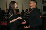 Jill Flint and Mike Woods chat during the ADAPT Santa Project Party Casino Night at the Down Town Association on December 03, 2019 in New York City.