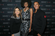 Ines Rosales, Camilla Barungi and Mike Woods pose for a photo at he ADAPT Santa Project Party Casino Night at the Down Town Association on December 03, 2019 in New York City.