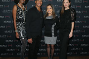 Camilla Barungi, Mike Woods, Ines Rosales and Jill Flint pose for a photo at the ADAPT Santa Project Party Casino Night at the Down Town Association on December 03, 2019 in New York City.