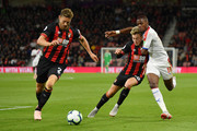Simon Francis of AFC Bournemouth battles for posession withWilfried Zaha of Crystal Palace and David Brooks of AFC Bournemouth during the Premier League match between AFC Bournemouth and Crystal Palace at Vitality Stadium on October 1, 2018 in Bournemouth, United Kingdom.
